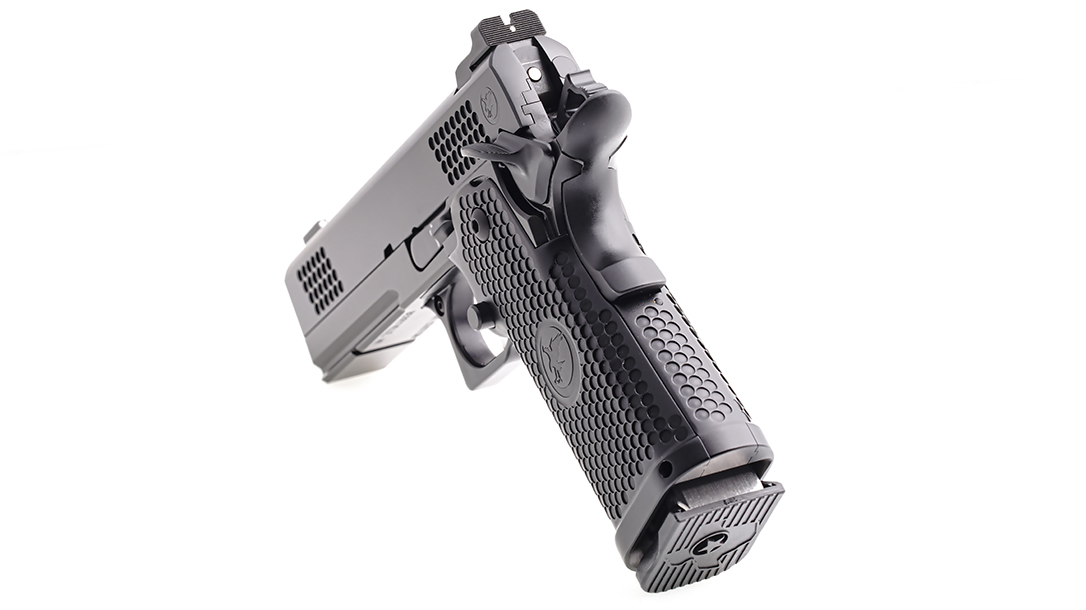 The pistol features dimples for non-abrasive, snag-free grip.