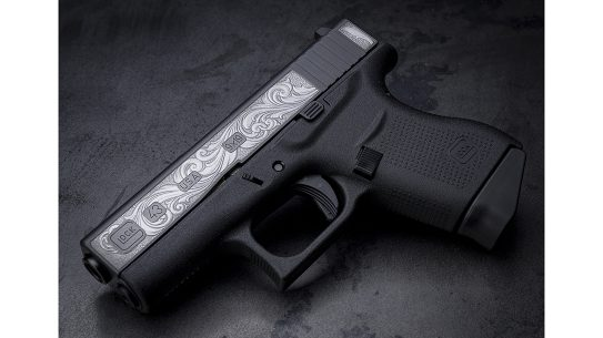 Built to carry, the Davidson's Glock 43 stands out with remarkable engraving on both sides of the slide.
