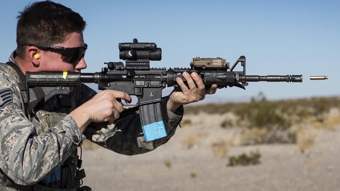 A U.S. airmen fires a Colt manufactured M4 carbine.