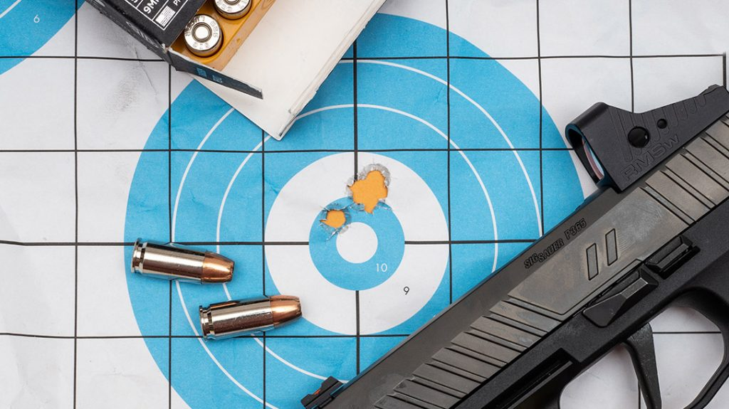 The author was able to achieve a tight group with the custom P365XL from 7 yards.