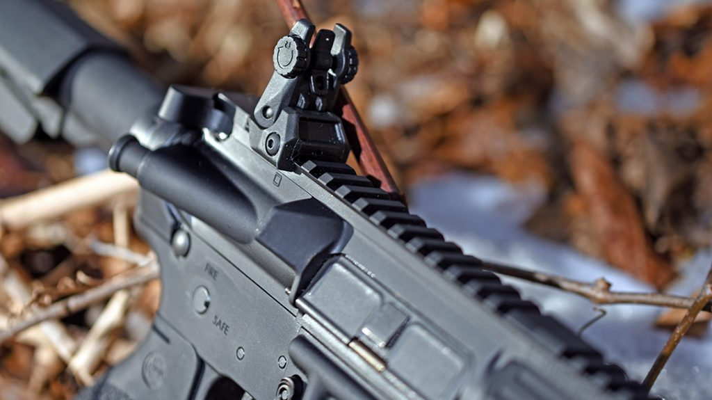 The RRA NSP flip-up front and rear sights require the use of both hands to pull into place.