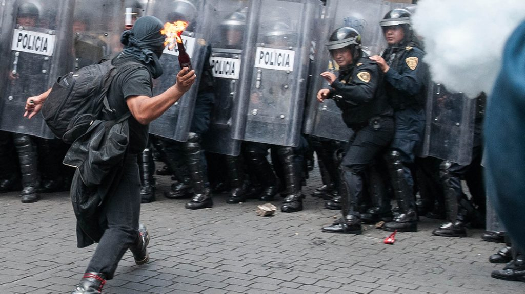 A leftist anarchist with a Molotov cocktail. Civil unrest is a growing problem worldwide.