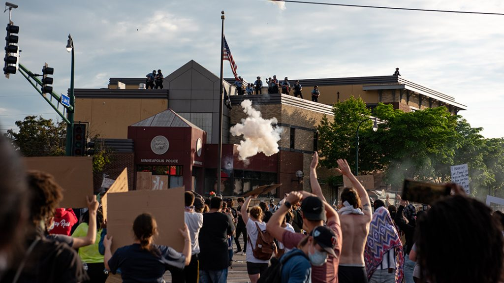 Protesters surround a police precinct, part of a larger wave of civil unrest in 2020.